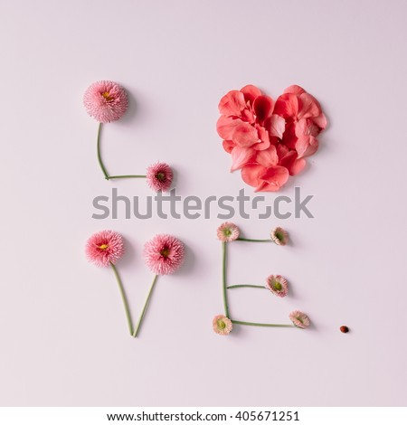 """""""Love"""" made of flowers and petals on white background. Love concept. Flat lay. - stock photo"""