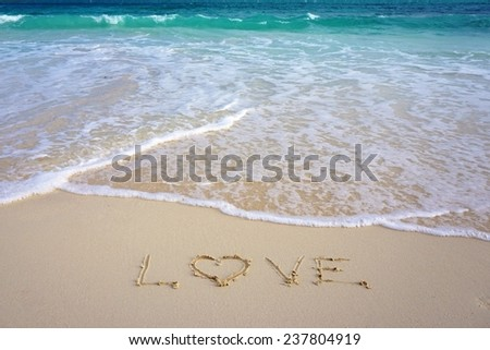 """""""Love"""" written in the sand on the beach - stock photo"""