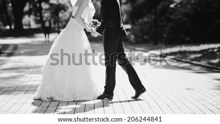 Loving newlywed couple outdoor. Bride and Groom at wedding Day. - stock photo