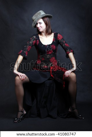 Low key lighting studio shot young attractive women with hat.Great image for calendar. - stock photo