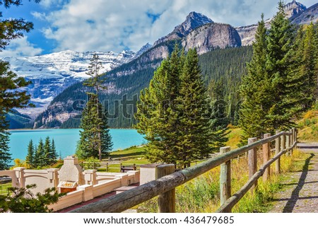 Low wooden fence on the shore of Lake Louise. Canada, Rocky Mountains, Alberta, Banff National Park - stock photo