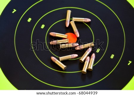 .22 LR caliber ammo and target - stock photo