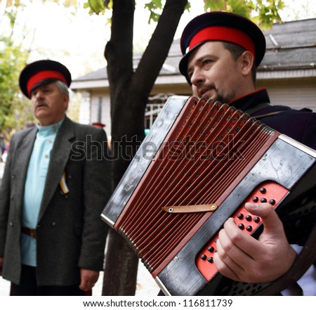 LUGANSK - OCT 14: Don Cossack singing old songs with garmon, celebration of the Protection of the Mother of God, Lugansk, Ukraine, October 14, 2012