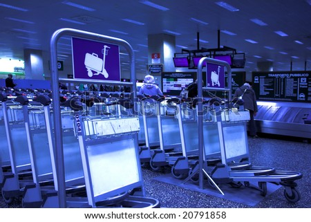 Luggage carts at nternational airport - stock photo