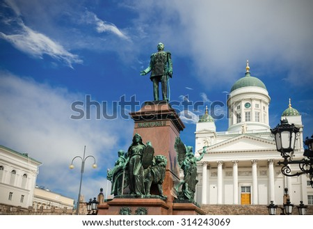 Lutheran cathedral and monument to Russian Emperor Alexander II in the Old Town of Helsinki, Finland - stock photo