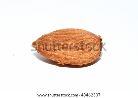 Macro shot of an almond nut on white background.