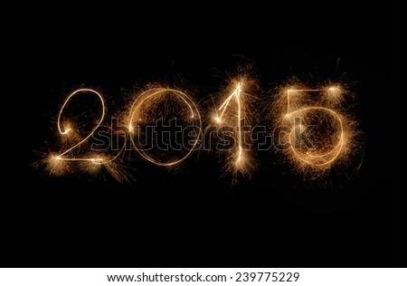 2015 made by sparkler on a black background - stock photo