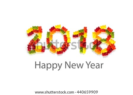 2018 made from colorful gummy bears  isolated with small shadows on a white background and sample text Happy New Year - stock photo