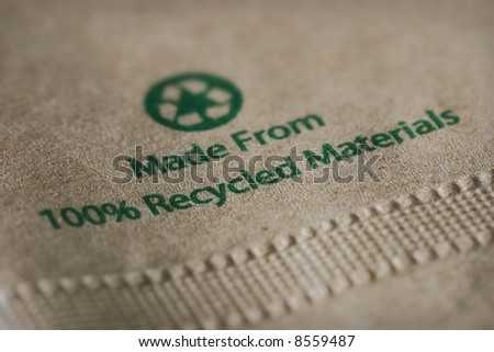 """Made From 100% Recycled Materials"" with focus on the word ""recycled."" - stock photo"