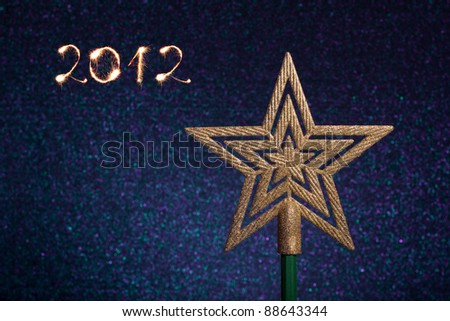 2012 made of sparkles and a gold star - stock photo
