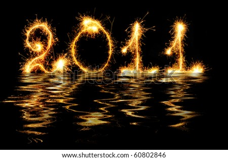 2011 made of sparks in water. A photo path bengal fires - stock photo