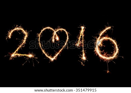 2016 made with sparklers on black background - stock photo