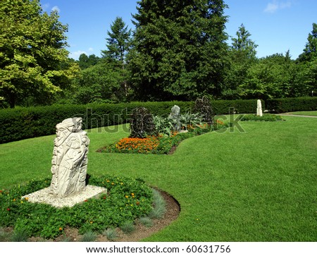 magic garden with flowerbeds in late summer - stock photo