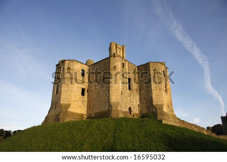 Magnificent Warkworth Castle on the North East coast in Northumberland - stock photo