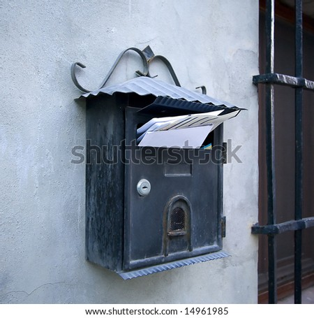 mail box on a wall full of letters - stock photo