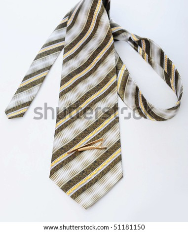 Male tie, mobile and pen - stock photo