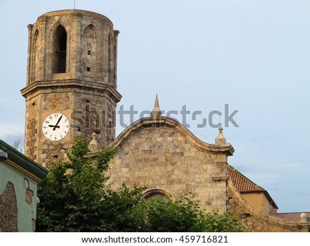 04.07.2016, Malgrat de Mar, Spain: Old stone medieval Church of St Nicolau. - stock photo