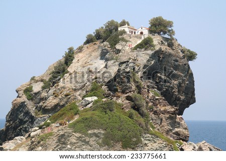 'Mamma Mia' Church. The chapel of St John the Baptist sit on top of a huge rock on the island of Skopelos in the Aegean sea. The wedding scene in 'Mamma Mia' starring Meryl Streep was filmed here. - stock photo