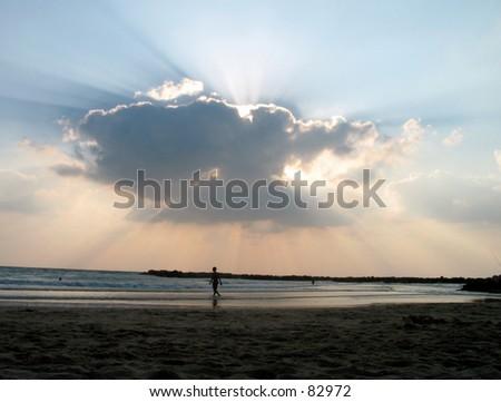 man  cloud Tel aviv sunset - stock photo