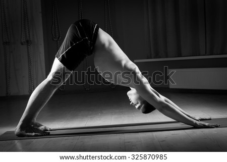 man doing yoga in the gym - stock photo