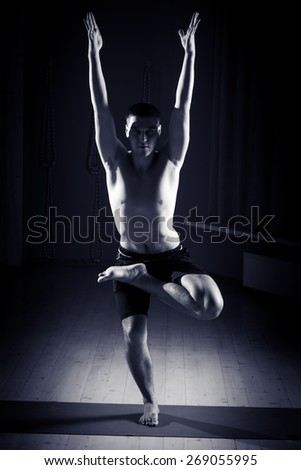 man doing yoga in the gym, black and white