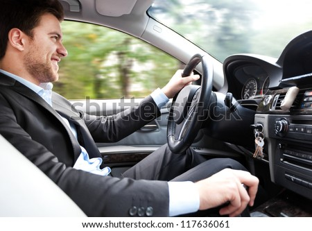Man driving his car