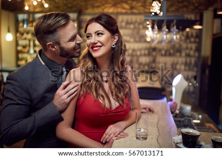 Man flirt to beautiful woman inside at evening