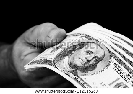 man hand holding american money