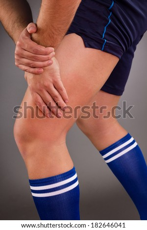 Man having pain in muscle, healthcare and medical concept.Gray background - stock photo