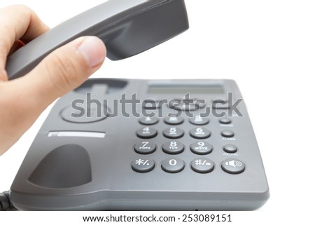 man holding up the phone receiver isolated on white background  - stock photo
