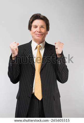 man in a suit enjoys a successful business deal - stock photo