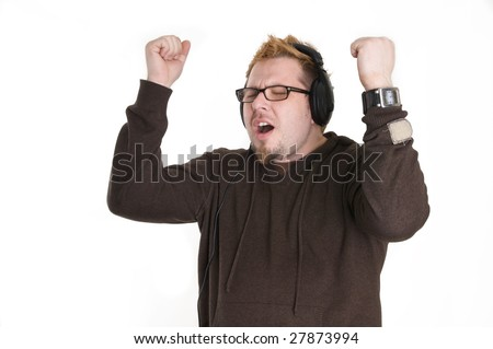 man in headphones listens to music and dancing - stock photo