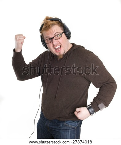 man in headphones listens to music and dancing