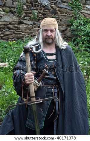 Man in the Gothic costume - stock photo