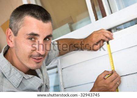 Man measures window - stock photo