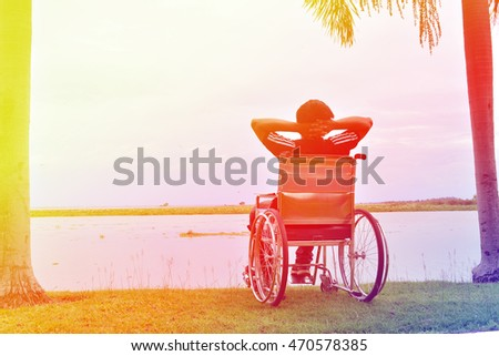 man on wheelchair in nature. Vintage tone