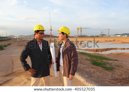 man survey or civil engineer stand on ground working over Building construction site. examination, inspection, survey