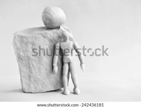 man under rock - illustration based on own photo image - stock photo