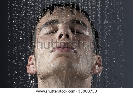 man under the shower - stock photo