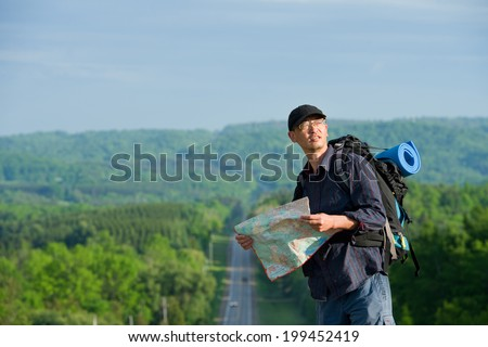 man walking on a countryside road