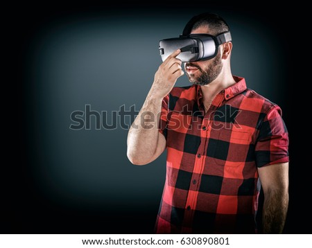 Man wearing virtual reality goggle, cyberspace and people concept