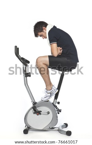 man who pedal stationary bikes - stock photo