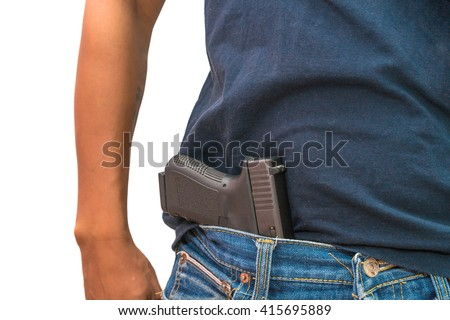 man with gun tucked in pants. - stock photo