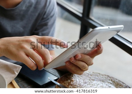 man working on tablet - stock photo