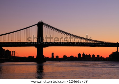 Manhattan bridge Sunrise New York skyline - stock photo