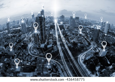 Map pin flat above blue tone city scape and network connection concept  - stock photo