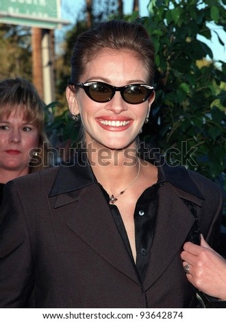 10MAR98:  Actress JULIA ROBERTS at the Blockbuster Entertainment Awards, in Los Angeles, where she won the award for Favorite Comedy Actress. - stock photo