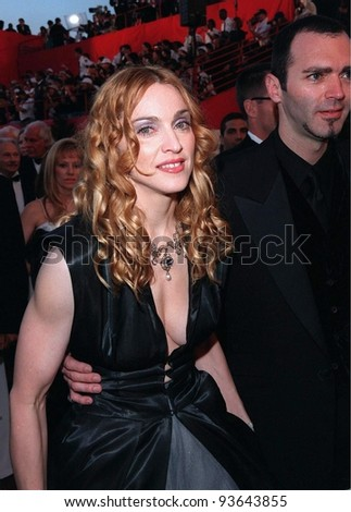 23MAR98:  Pop star/actress MADONNA & brother at the 70th Academy Awards. - stock photo