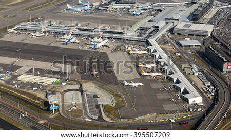 16 March 2016, Amsterdam. Aerial view of the M-gate and G-gate at Schiphol Airport with planes from Easyjet, Flybe, Garuda Indonesia and ArkeFly