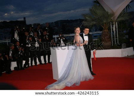 Maria Dragus and Crisitan Mungiu poses  the Palme D'Or Winner Photocall during the 69th annual Cannes Film Festival at the Palais des Festivals on May 22, 2016 in Cannes, France. - stock photo